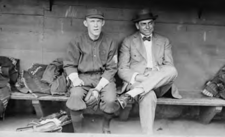 Johnny Evers (left) on the Braves in 1914 with his manager, George Stallings (right). As player-manager of the Cubs in 1913, Evers took himself out of the lineup against left-handers, but George Stallings (right) used handedness substitutions in the Braves' lineup regularly for strategic advantage starting in 1913.