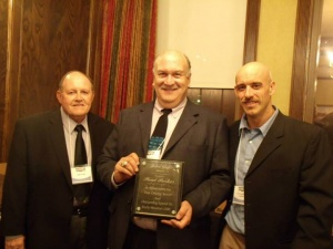 Paul Parker: receives the Rocky Mountain Chapter's John Zajc Award. Pictured with John Paul (l) and Matt Repplinger (r).