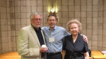 Author, left, receives his 2014 Seymour Medal at the NINE Conference banquet with Marc Appleman, center, and Dorothy Seymour Mills