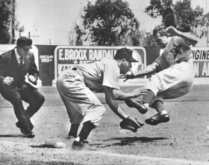 Photo 1: The trigger for the biggest brawl in PCL history. Hollywood Stars outfielder Ted Beard slides spikes-high into Los Angeles Angels third baseman Murray Franklin, August 2, 1953.