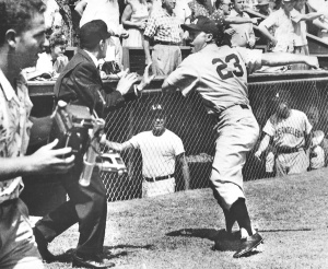 Photo 3: The brawl spreads as Angels catcher Al Evans winds up for a swing at umpire Joe Iacovetti.