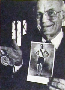 Ellery Clark Jr.: holding the two first-place medals his father won at the 1896 Olympic Games in Athens, Greece.