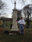 stands beside the restored grave marker for Jim Creighton, baseball's first superstar, at Green-Wood Cemetery in Brooklyn.