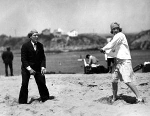 Baseball break: Buster Keaton and wife Natalie Talmadge take a baseball break.