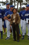 Dodgers players tower over the 5-foot-2-inch Ng as she listens during a spring training meeting in Vero Beach, Florida.
