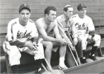 Joe Faria, Pete Barisoff, Ben Geraghty and Milt Cadinha, left to right, watch a reorganized Spokane Indians practice following a deadly bus crash on June 24, 1946, that killed nine members of the team.