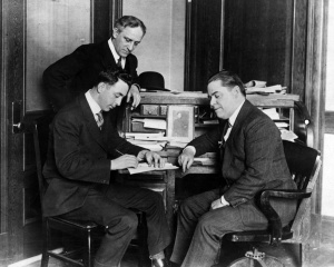 Jack Barry and Harry Frazee: Red Sox player-manager, left, signs his 1917 contract as owner Frazee looks on.