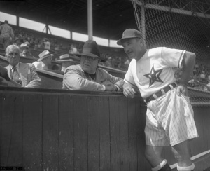 Fred Haney: (right), wearing the Hollywood Stars' new shorts and lightweight rayon jerseys, visits with Branch Rickey in 1950 at Gilmore Field.