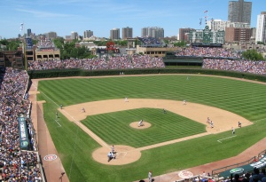 Peace and prosperity: A funny thing happened on Wrigley's way to extinction. The Cubs learned to co-exist with the neighbors and the city, instituting income-sharing with rooftop owners, a bleacher expansion, and high-priced field seats.