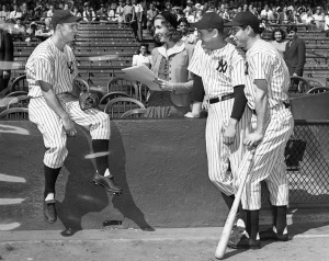 Jeane Hoffman: brought her reporter's notebook and cartoonist's sketch pad to Yankee Stadium in 1940. Shown here interviewing Yankee teammates Joe Gordon (left), Lefty Gomez, and Joe DiMaggio (far right).
