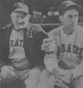 Honus Wagner: gives Johnny Rizzo (right), a promising Pittsburgh outfielder purchased from Columbus, a few pointers during an exhibition game.