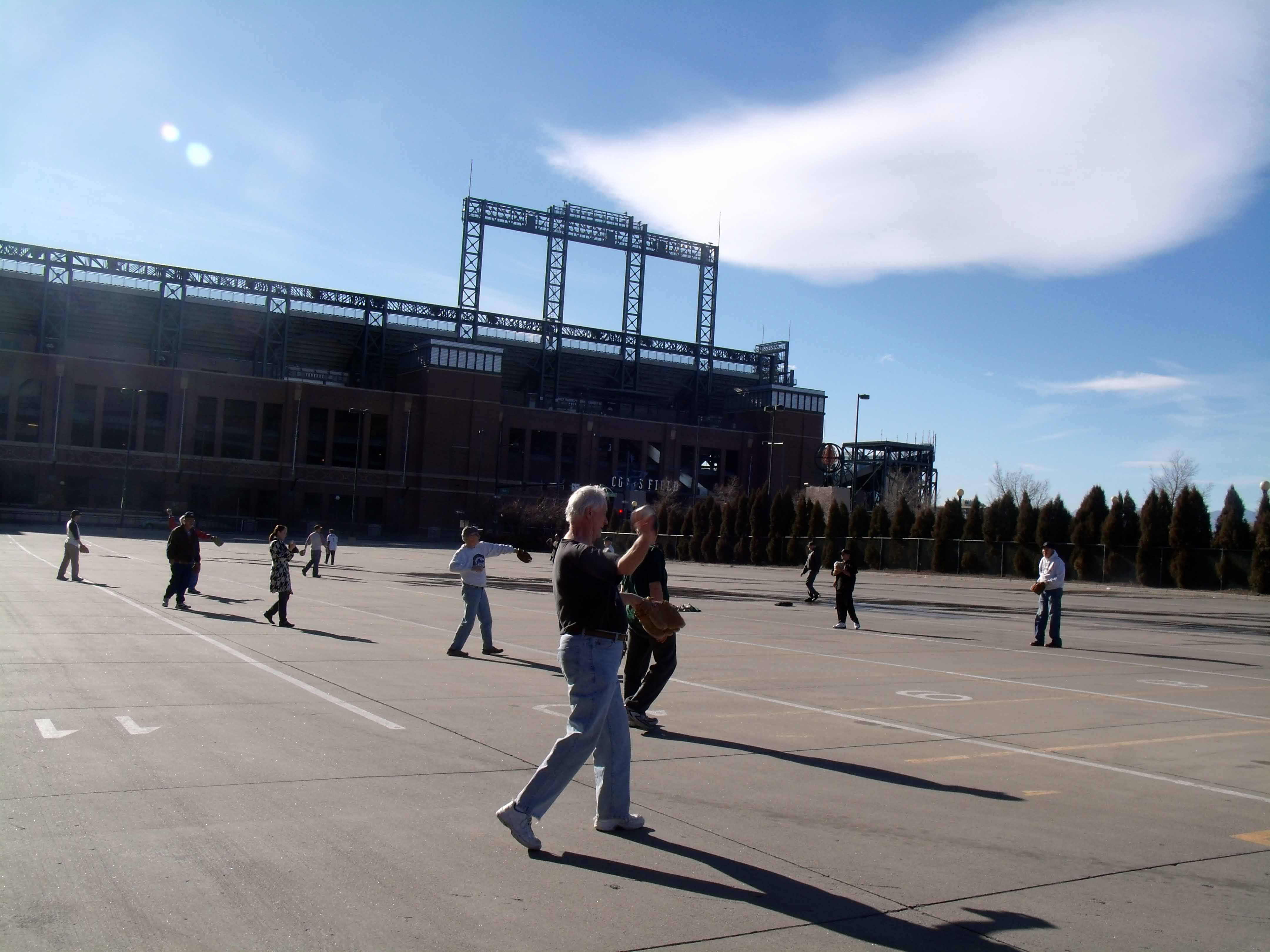 SABR members play catch in the parking lot outside Coors Field.