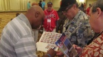 Former White Sox player signs autographs for SABR 45 attendees.