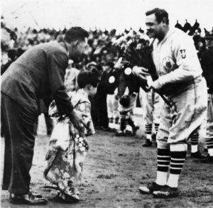 Babe Ruth: Presented with flowers before a game during the 1934 baseball tour of Japan.