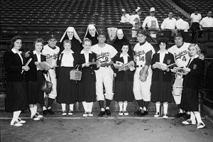 Dodgers players: pose with students and nuns at the Academy of St. Aloysius, a Catholic girls' school in Jersey City, June 5, 1957.