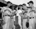 A high school student and pitcher for the Babe Ruth Eastern team, Simmons (third from left) is shown with teammates and Carl Hubbell (left) at the American Legion all-star game at the Polo Grounds in 1945.