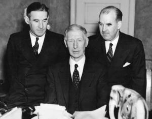 The Mack family: With the election of Connie Mack (center) as president of the Athletics in January 1937, the Mack family, including Earle (left) and Roy (right), now controlled all of the senior leadership positions in the club's front office.