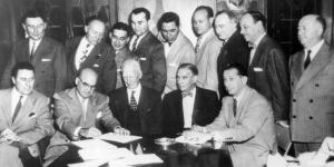 Roy Mack: affixes his signature to an agreement selling the Athletics to the Philadelphia syndicate on October 17, 1954—a commitment Roy would betray just a day later in a backroom deal with Arnold Johnson.