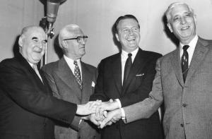 A's sold: Handshakes and smiles are all around as Arnold Johnson and his allies celebrate after league owners agreed to the sale and relocation of the A's to Kansas City on November 8, 1954. From left: Roy Mack, league president William Harridge, Arnold Johnson, and Kansas City mayor William E. Kemp.