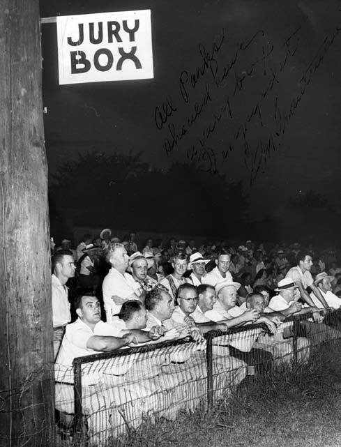 "The jury box was a section behind third base at Jennings Field reserved for the most vocal fans. When George Trautman, president of the Minor Leagues, visited in August 1951, he insisted on sitting there. Trautman, third from the left in the front row, inscribed this photo: ""All parks should have a jury box. I enjoyed it."""