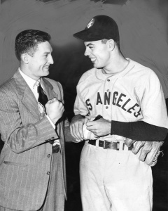 Cliff Chambers: Winning pitcher of the 1947 PCL playoff game autographs the cast of injured boxer Eddie Malone.