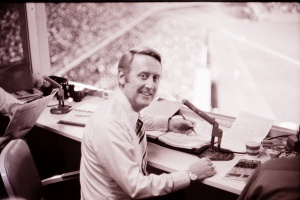 Vin Scully: The Dodgers' most valuable lefty keeps score as he broadcasts a Dodgers-Mets game at Dodger Stadium in the 1960s.