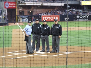 Four umpires at work: Left to right: Chris Guccione, Brian O'Nora, Phil Cuzzi, and Jerry Crawford