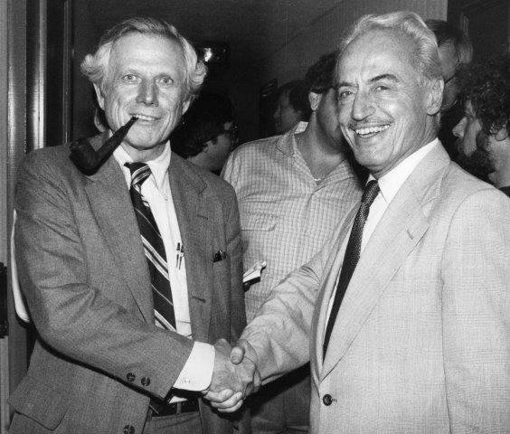 Ray Grebey, chief negotiator for the owners, shakes hands with Marvin Miller
