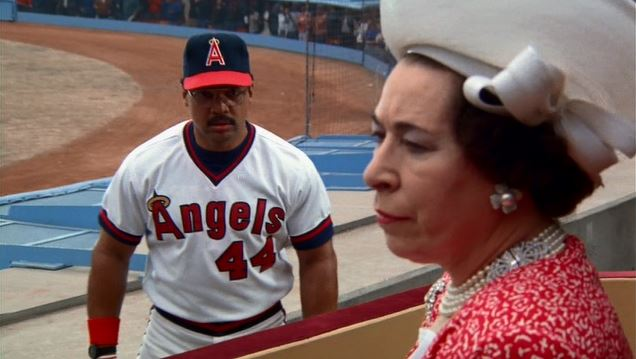 "Reggie Jackson and Jeanette Charles (as Queen Elizabeth) in ""The Naked Gun"""