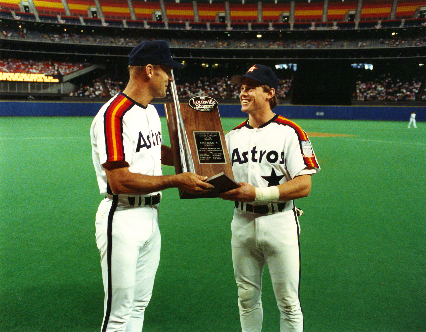 The Astrodome saw its share of stars over the years, including Biggio, who receives his 1989 Silver Slugger Award from manager Art Howe, left.