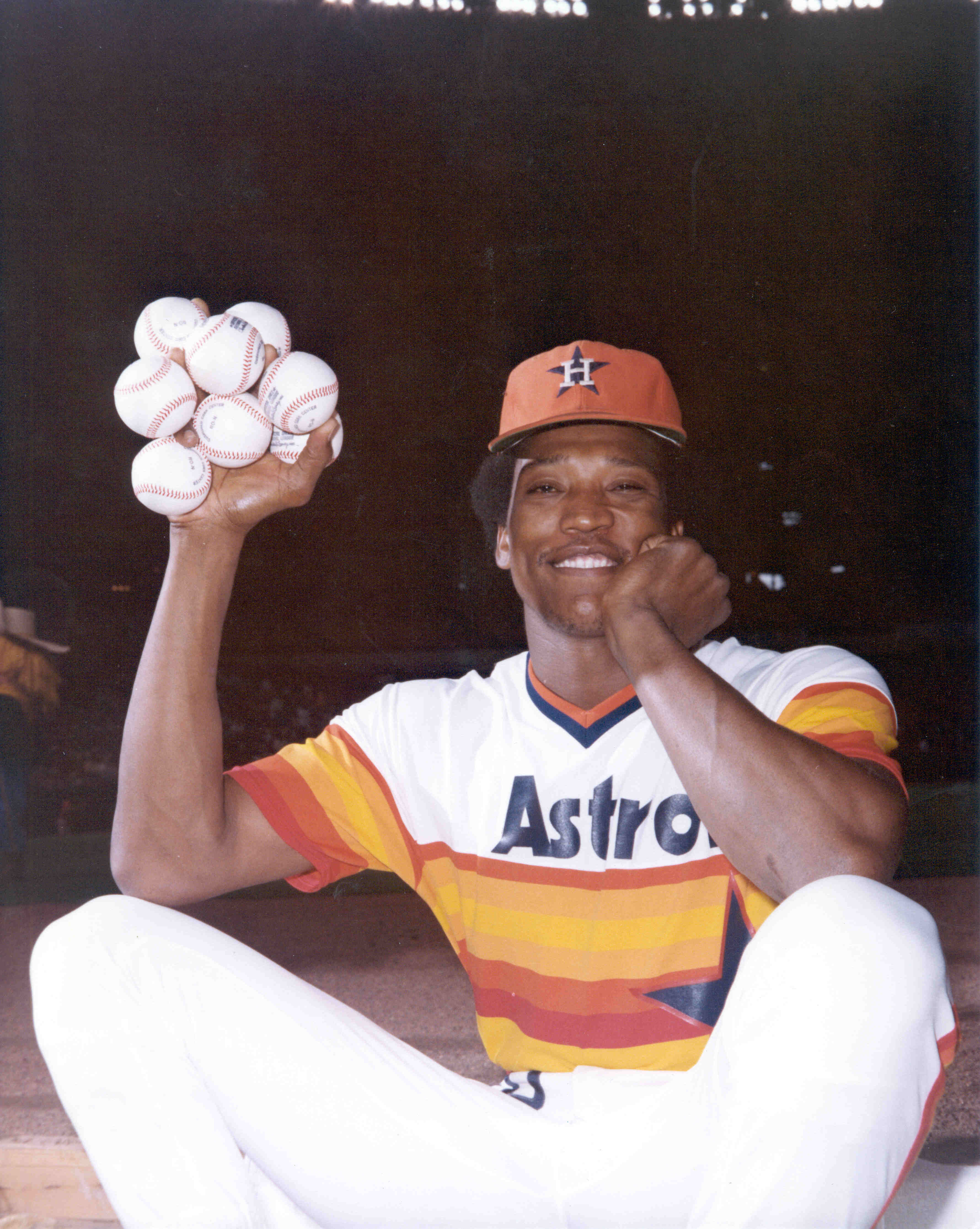 At the peak of his career, holding eight baseballs with his enormous pitching hand.
