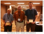 Larry Ritter Award winners Chuck Kimberly, left, and Nathaniel Grow, right, pose with Dr. Charles Alexander in Chicago.