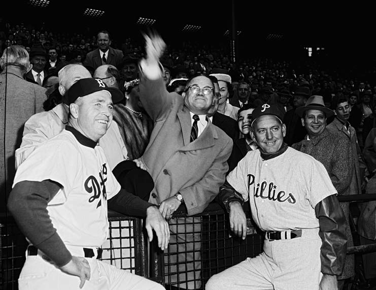 throws out the first pitch at the Dodgers–Phillies game, April 19, 1956, the first of fifteen games—fourteen regular-season, one exhibition—that the Dodgers would play at Roosevelt Stadium during the 1956 and 1957 seasons.