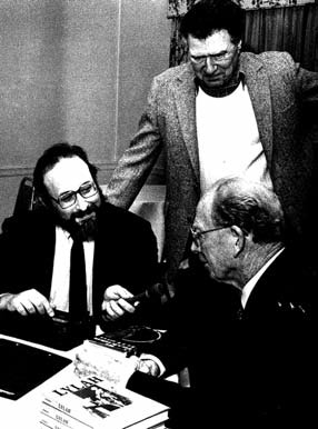 Lawrence Ritter, standing, looks on as Lee Lowenfish, left, interviews Red Barber at Polk Award ceremonies, Long Island University, circa 1985. A shy man, Ritter summoned the courage to call retired players and discovered that most of them were eager to tell their stories.