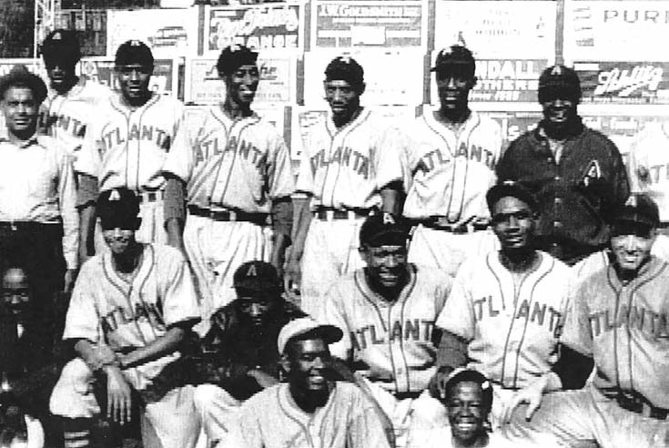 Red Moore (in lower right corner) stands with his teammates.